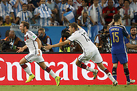 Mario Gotze of Germany celebrates scoring a goal with Thomas Muller after making it 1-0