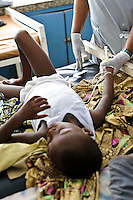 A young patient receiving drugs through a canula at the Ola During paediatric hospital, Freetown, Sierra Leone. The Welbodi Partnership works to support the Ministry of Health and Sanitation in Sierra Leone to deliver high quality paediatric care.  The work of the charity is designed to stimulate lasting change, whether through one-time investments with long-term benefits, or ongoing engagement around key issues, and the charity's long-term commitment is reflected in its approach to funding - their aim is to establish an endowment fund for the hospitals with which they work..The charity's work is conceived, designed, led and implemented by local partners. Hospital staff in Sierra Leone often already know the best solutions to the numerous problems they face, and where they don't, they are the best judges of new ideas. So the role of the Welbodi Partnership is to coordinate funding, international expertise and local know-how to facilitate improvements in the delivery of health care.  They also work to build relationships and consensus with leaders within the Government of Sierra Leone, local health facilities, donors, NGOs and international partners..Welbodi Partnership works to instil a culture of innovation and excellence with partners and their team of experts. They constantly question the assumptions that underlie their work and the tools that they use, evaluate their efficacy and adapt what they do appropriately.