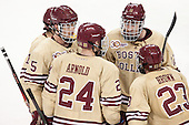 Johnny Gaudreau (BC - 13), Michael Matheson (BC - 5), Bill Arnold (BC - 24), Kevin Hayes (BC - 12) and Patrick Brown (BC - 23) confer before a faceoff. - The Boston College Eagles defeated the visiting University of Notre Dame Fighting Irish 4-2 to tie their Hockey East quarterfinal matchup at one game each on Saturday, March 15, 2014, at Kelley Rink in Conte Forum in Chestnut Hill, Massachusetts.