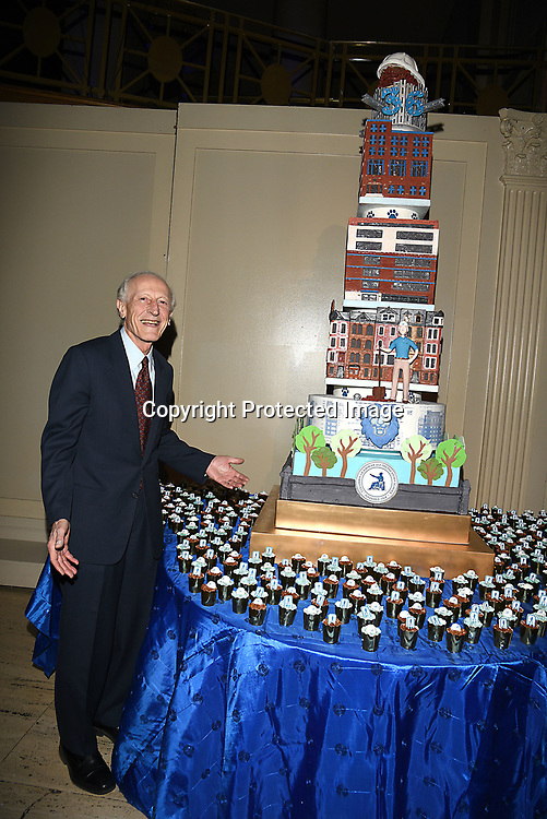 Dr Richard Soghoian and the cake attend the Columbia Grammar & Prep School 2017 Benefit on March 8, 2017 at Cipriani Wall Street in New York, New York.