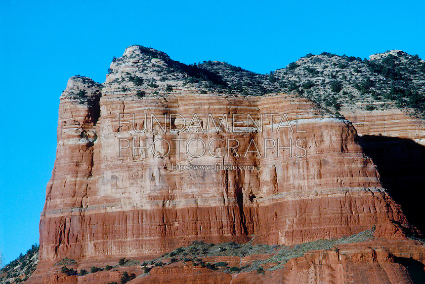 SEDIMENTARY ROCK FORMATIONS WITH WIND &amp; WATER EROSION<br /> Sandstone &amp; Limestone buttes near Sedona, AZ