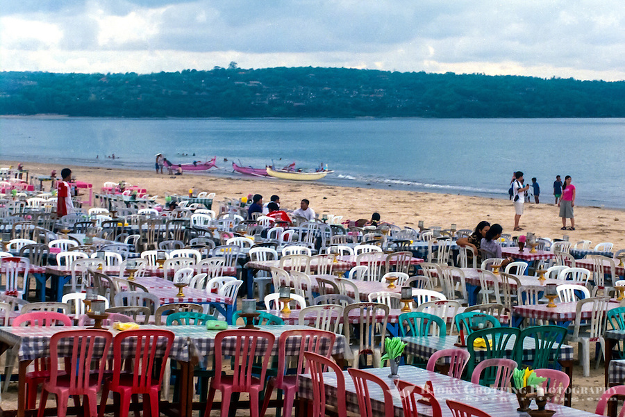 Bali, Badung, Jimbaran. Restaurant at the sea. You can sit at a table on the beach, it can be quite crowded here by sunset.