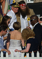 Baltimore Police Commisioner Fred Bealefeld gets his photo taken with Zac Brown before the Preakness Stakes at Pimlico Race Course on May 19, 2012