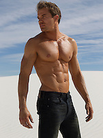 man with a flawless body out in the desert in New Mexico