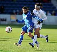 US midfielder Carli Lloyd (10) pressures  Italian midfielder Pamela Conti (10).  The U.S. Women's National Team defeated Italy 1-0 at Toyota Park in Bridgeview, IL on November 27, 2010 to advance to the Women's World Cup in Germany.