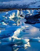 Ice Floes, Jokulsarlon Lagoon Preserve, Iceland Ice calving from Vatnajokull Glacier   Midnight Sun light