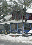Falling snow obscures the view of Planet X Cafe in downtown Rehoboth Beach, Delaware, USA, early in the blizzard of February 2010.