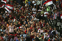 Disappointed Egyptian fans watch as the clock counts down on their defeat against Costa Rica during the FIFA Under 20 World Cup Round of 16 match between Egypt and Costa Rica at the Cairo International Stadium on October 06, 2009 in Cairo, Egypt.