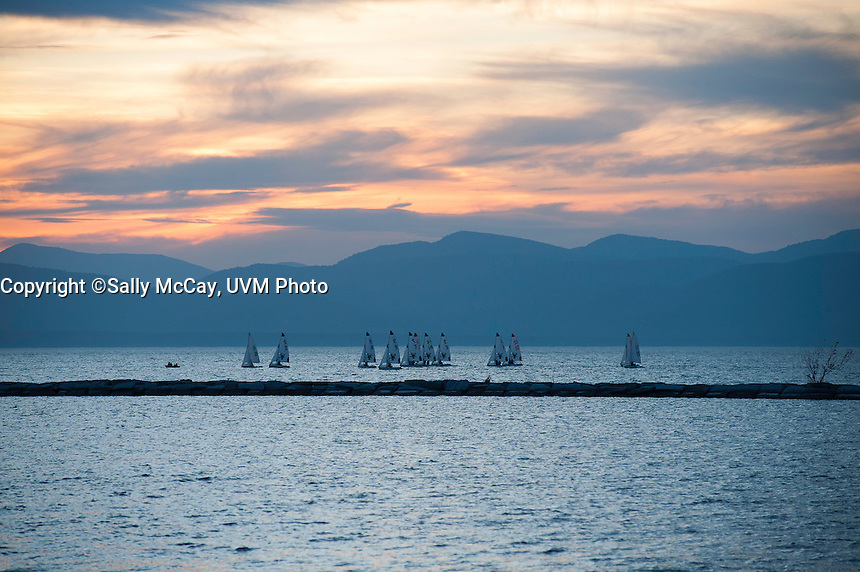 The UVM Sailing Team practices at sunset on Lake Champlain. Burlington, Vermont and Lake Champlain