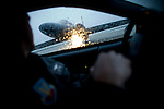 Major Doug McMahon drives a chase car and double-checks a U2 before take-off at Beale Air Force Base February 23, 2010 in Linda, Calif.