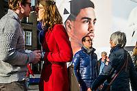 Nederland, Amsterdam, 13 maart 2016<br /> Stelletje op de Dam en groot billboard op de achtergrond.<br /> Foto (c) Michiel Wijnbergh