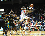 Ole Miss' Murphy Holloway (31) is fouled by Coastal Carolina's Badou Diagne (23) at the C.M. &quot;Tad&quot; Smith Coliseum in Oxford, Miss. on Tuesday, November 13, 2012. (AP Photo/Oxford Eagle, Bruce Newman)