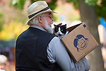 A pet owner waits with his cat to get it blessed during an outdoor church service commemorating St. Francis.