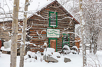 Historic general store log cabin in winter, Wiseman, arctic, Alaska.