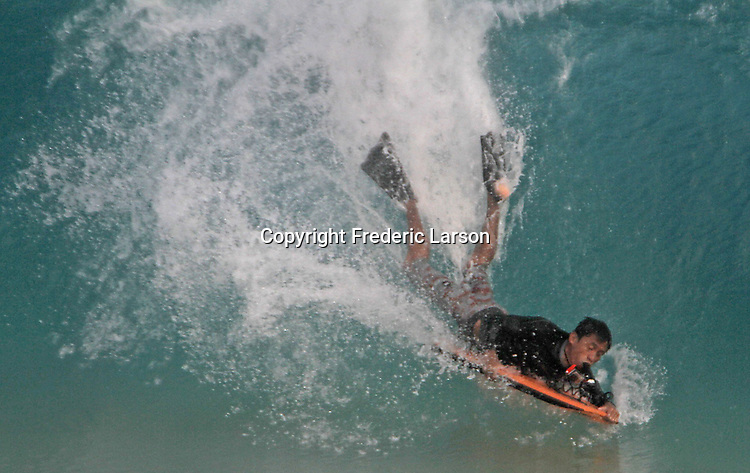 A boarder at Sandy Beach in Hawaii finds his wave.