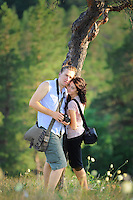 Couple on top of a hill near the steep