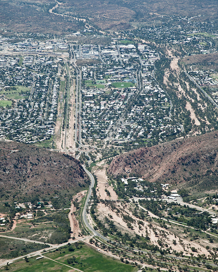 Aerial view of Alice Springs, the Stuart Highway, Todd River and Ghan Railway passing through Heavitree gap.