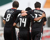 Carey Talley #8 and Chris Pontius #13 with Andy Najar #14 of D.C. United after Najar's goal during an MLS match against Chivas USA at RFK Stadium, on May 29 2010 in Washington DC. United won 3-2.