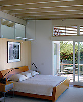 This contempoarary bedroom opens onto a wraparound terrace that overlooks San Francisco Bay