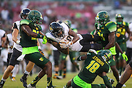 Tampa, FL - September 2, 2016: Towson Tigers wide receiver Andre Dessenberg (18) gets tackled by several USF defenders during game between Towson and USF at the Raymond James Stadium in Tampa, FL. September 2, 2016.  (Photo by Elliott Brown/Media Images International)