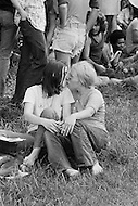 27 Jun 1971 --- Couple kissing as demonstrators gather for the second Gay Pride Parade in New York City. --- Image by © JP Laffont/Sygma/CORBIS