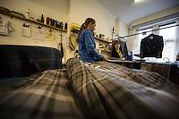 Glasgow- Sartoria kilt , lavoro di preparazione di un kilt