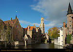 Canal Scene: Djiver at Rozenhoedkaai Red Hat Quay, Wollestraat Hotels, Belfort Bell Tower, Duc de Bourgogne and Huidevettershuis Tanner's Guild Tower, Bruges, Brugge, Belgium