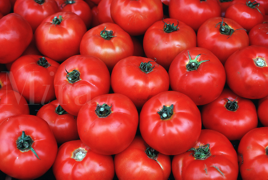 A pile of fresh red tomatoes.