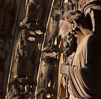 Statue of St Bartholomew or Nathanael, on the right splay of the central bay of the South Portal depicting the Last Judgement, 12th century, Chartres Cathedral, Eure-et-Loir, France. In the distance, the hierarchy of the angels on the archivolts. Chartres cathedral was built 1194-1250 and is a fine example of Gothic architecture. It was declared a UNESCO World Heritage Site in 1979. Picture by Manuel Cohen.
