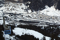 Switzerland. Canton of Ticino. Airolo. Overview of the village in the Leventina valley. The entrance of the Gotthard Road tunnel. The Gotthard Road Tunnel in Switzerland runs from Göschenen in the Canton of Uri at its northern portal, to Airolo in Ticino to the south, and is 16.9 kilometres (10.5 mi) in length below the Gotthard Pass, a major pass of the Alps. It is the third-longest road tunnel in the world. The road to the Saint Gotthard pass is closed for the winter season. The cable car arrives at Peschün ski resort. © 2005 Didier Ruef