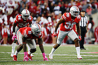 Ohio State Buckeyes linebacker Chris Worley (35) and Ohio State Buckeyes defensive end Jalyn Holmes (11) during the fourth quarter of a NCAA Division I college football game between the Ohio State Buckeyes and the Indiana Hoosiers on Saturday, October 8, 2016 at Ohio Stadium in Columbus, Ohio. (Joshua A. Bickel/The Columbus Dispatch)