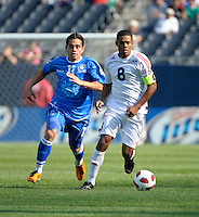 Cuba's Jaine Colomé dribbles down the field while being pursued by El Salvador's Rodolfo Zelaya.  El Salvador defeated Cuba 6-1 at the 2011 CONCACAF Gold Cup at Soldier Field in Chicago, IL on June 12, 2011..