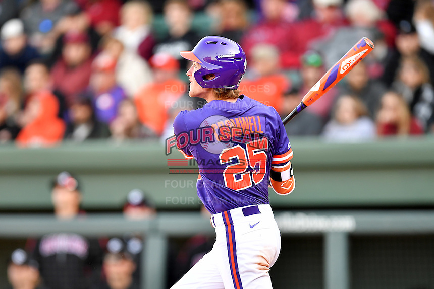 Third baseman Patrick Cromwell (25) of the Clemson Tigers homers in the ninth inning in the Reedy River Rivalry game against the South Carolina Gamecocks  on Saturday, March 4, 2017, at Fluor Field at the West End in Greenville, South Carolina. Clemson won, 8-7. (Tom Priddy/Four Seam Images)