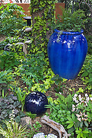 A blue urn and a ceramic sphere seem to fit perfectly into the shade garden in Dan Johnson's Denver front yard.