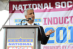 10 October 2013: U.S. Soccer Federation president Sunil Gulati introductes 2013 inductee Peter Vermes (not pictured). The 2013 National Soccer Hall of Fame Induction Ceremony was held on the West Plaza outside Sporting Park in Kansas City, Kansas.