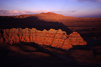 Honeycomb Buttes catch early morning light in the Red Desert, a wilderness study area. ..Wyoming's Red Desert was included in The Wilderness Society's list of &quot;15 Most Endangered Wildlands&quot; because of massive oil and gas development in the wild heart of this 600,000 national treasure. The desert's stunning rainbow colored hoo-doos, towering buttes and prehistoric rock art, define this rich landscape and provide a truly wild &quot;home on the range&quot; for the largest migratory game herd in the lower 48 states - over 50,000 pronghorn antelope in addition to a rare desert elk herd...