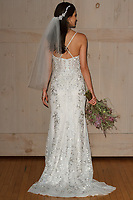 Model poses in a Melissa Sweet bridal gown for the David's Bridal Fall 2017 fashion show presentation on April 19, 2017; during New York Bridal Fashion Week.