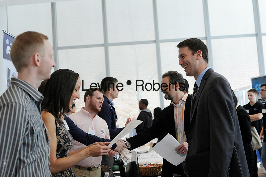 Job seekers attend the Fourth Annual NYC Startup Job Fair in New York on Friday, April 19, 2013.  The Labor Department reported a rise in unemployment benefit applications for last week. (© Frances M. Roberts)