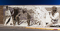 Early fossil hunters are the subjects of a mural on the Ace Hardware store in Kemmerer, Wyoming..  The town is nine miles from the Fossil Butte National Monument  in southwestern Wyoming.