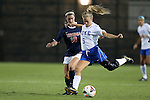 26 September 2013: Duke's Kaitlyn Kerr (5) and Virginia's Annie Steinlage (10). The Duke University Blue Devils hosted the University of Virginia Cavaliers at Koskinen Stadium in Durham, NC in a 2013 NCAA Division I Women's Soccer match. Virginia won the game 3-2.
