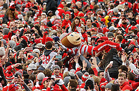 Brutus Buckeye crowd-surfs as Ohio State fans storm the field after the Buckeyes beat the Michigan Wolverines 30-27 in double overtime during Saturday's NCAA Division I football game at Ohio Stadium in Columbus on November 26, 2016. (Barbara J. Perenic/The Columbus Dispatch)