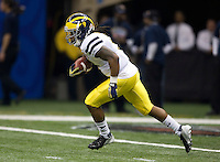 Martavious Odoms of Michigan runs the ball during Sugar Bowl game against Virginia Tech at Mercedes-Benz SuperDome in New Orleans, Louisiana on January 3rd, 2012.  Michigan defeated Virginia Tech, 23-20 in first overtime.