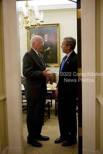 United States President George W. Bush confers with U.S. Senator Patrick Leahy (Democrat of Vermont) during a breakfast meeting Tuesday, July 12, 2005, with bipartisan members of the United States Senate.  .Mandatory Credit: Eric Draper / White House via CNP