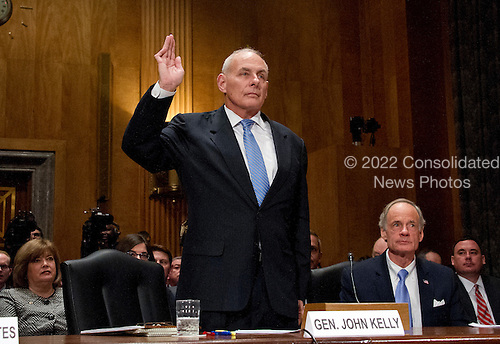 General John F. Kelly, USMC (Retired) is sworn-in to testify before the United States Senate Committee on Homeland Security and Governmental Affairs confirmation hearing on his nomination to be Secretary, US Department of Homeland Security on Capitol Hill in Washington, DC on Tuesday, January 10, 2017.  US Senator Tom Carper (Democrat of Delaware) looks on from the right.<br /> Credit: Ron Sachs / CNP