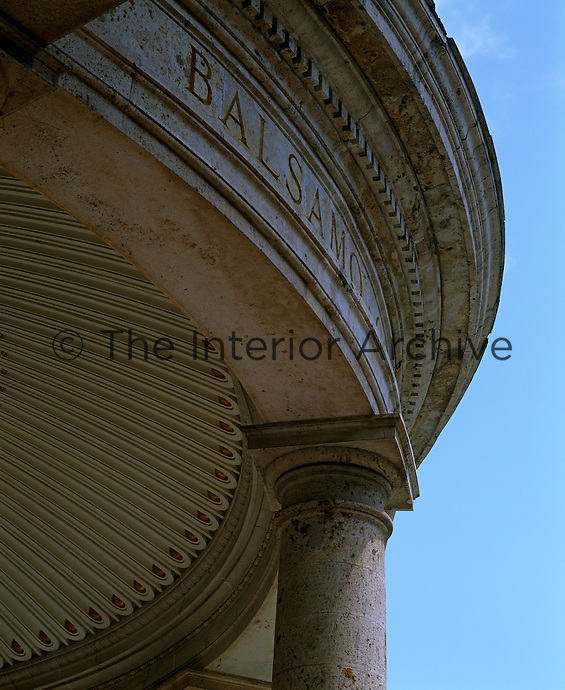 A detail of the curved pediment above one of the colonnades at the Tettuccio spa