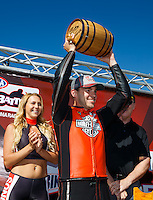 Jul 30, 2016; Sonoma, CA, USA; NHRA pro stock motorcycle rider Andrew Hines celebrates with the trophy after winning the Pro Bike Battle specialty race during qualifying for the Sonoma Nationals at Sonoma Raceway. Mandatory Credit: Mark J. Rebilas-USA TODAY Sports