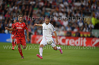 Cardiff City Stadium, Cardiff, South Wales - Tuesday 12th Aug 2014 - UEFA Super Cup Final - Real Madrid v Sevilla - <br /> <br /> Sevilla&rsquo;s Daniel Carrico and Real Madrid&rsquo;s Karim Benzema in action. <br /> <br /> <br /> <br /> <br /> Photo by Jeff Thomas/Jeff Thomas Photography