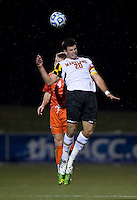 Jake Pace (20) of Maryland goes up for a header with Jack Metcalf (4) of Clemson during the ACC tournament semifinals at the Maryland SoccerPlex in Boyds, MD.  Maryland defeated Clemson, 1-0, in overtime.
