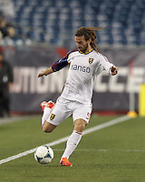 Real Salt Lake midfielder Kyle Beckerman (5) passes the ball.  In a Major League Soccer (MLS) match, Real Salt Lake (white)defeated the New England Revolution (blue), 2-1, at Gillette Stadium on May 8, 2013.