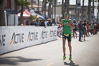 Heather Wurtele enjoys her win during the Accenture Ironman California 70.3 in Oceanside, CA on March 29, 2014.